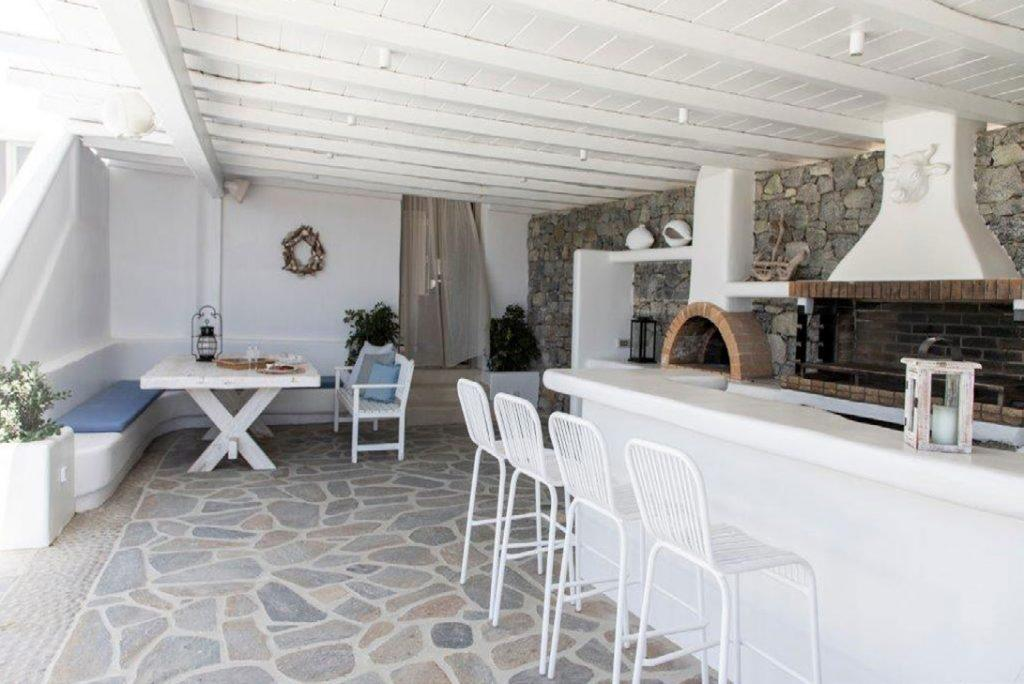 Villa-Sabina_17.jpg Kounoupas Mykonos, outdoor dining area, bar, high chairs, BBQ grill, dining table, bench