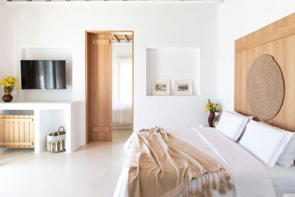 Villa-Sabina_38.jpg Kounoupas Mykonos, 4th bedroom, king size bed, pillows, flowers, vase, flat screen TV