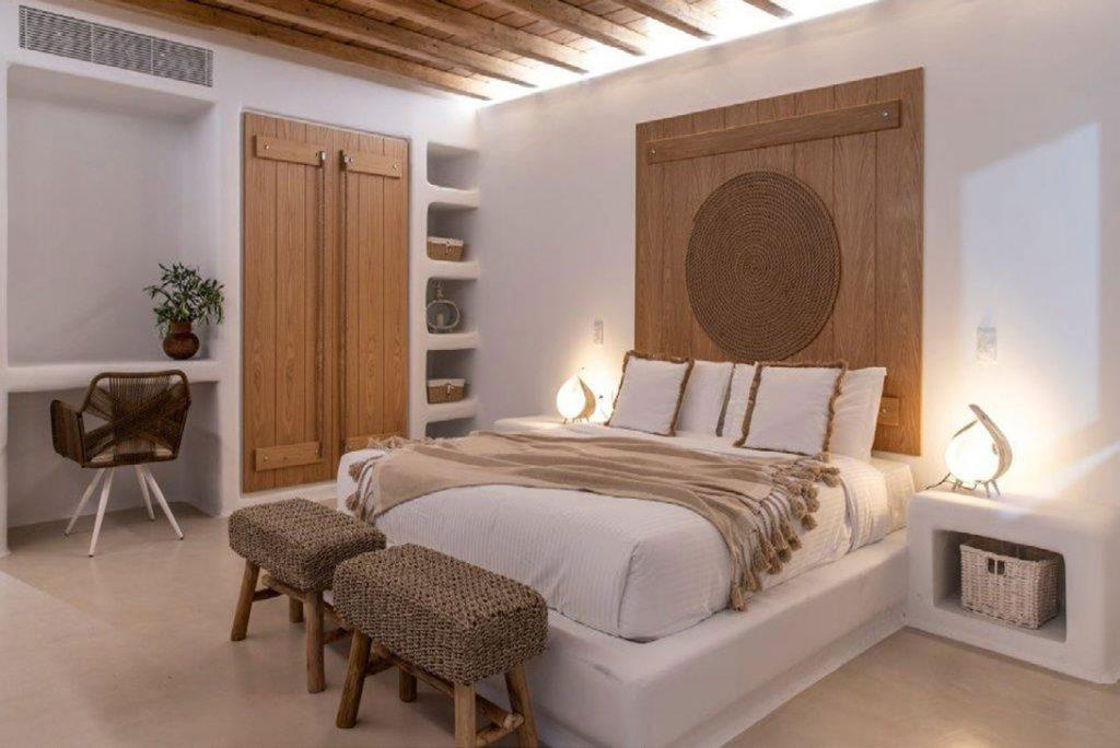 Villa-Sabina_41.jpg Kounoupas Mykonos, 6th bedroom, king size bed, nightstands, lamps, chair, desk, closet, shelves