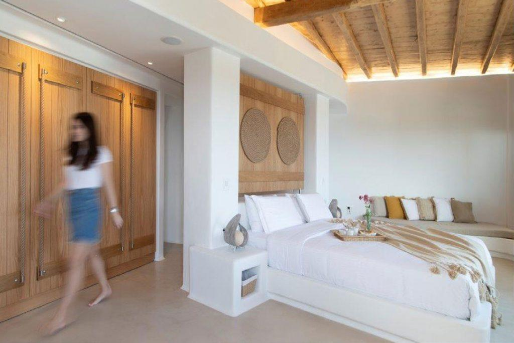 Villa-Sabina_49.jpg Kounoupas Mykonos, 7th bedroom, king size bed, sofa, pillows, blanket, nightstand, lamps, breakfast in bed, woman, closet