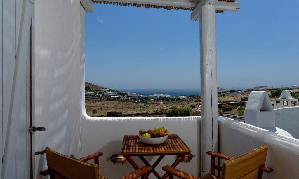 Villa-Valence-_14.jpg Kalafatis Mykonos, outdoor, balcony, chairs, table, fruits, bowl, sea view, sky view