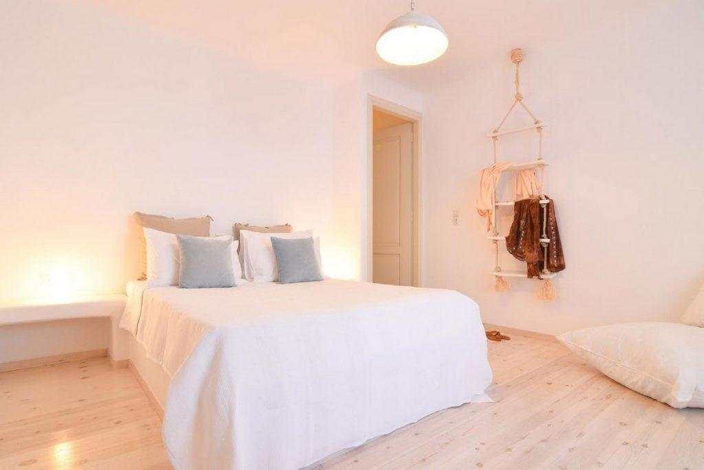 beautifully lit room with cozy bed and soft pillows for relaxing