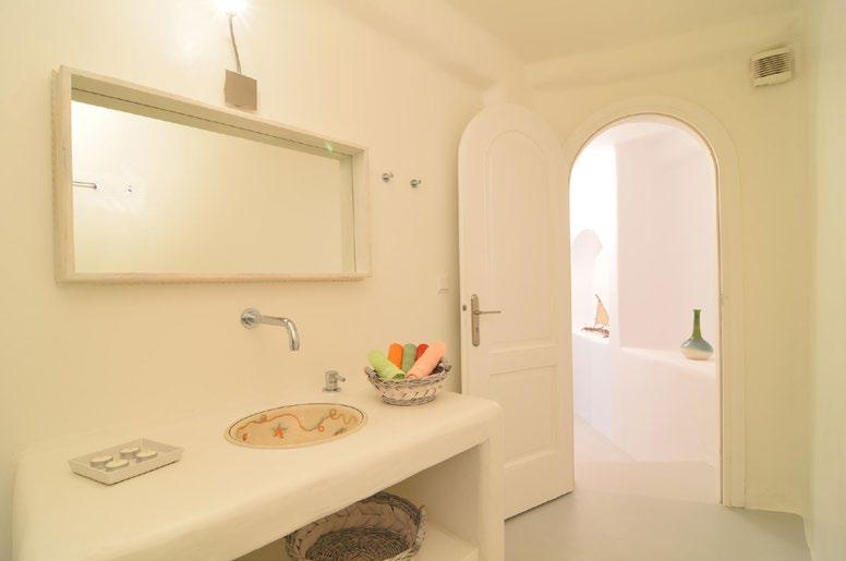 white wash walls with designed sink and lamp above