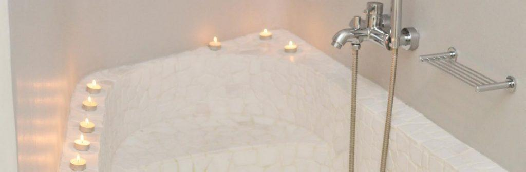 bathroom with ceramic bath and candles for romantic atmosphere