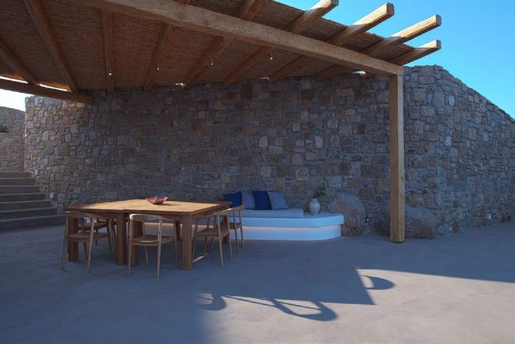 Villa_Jacob_08.jpg Kalafatis Mykonos Outdoor Dining area, bed, pillows, vase, table, chairs, stairs