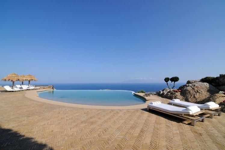 outdoor area with pool and infinity beautiful sea view
