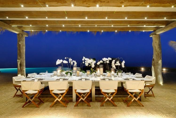 outdoor dining area with a nicely filled table