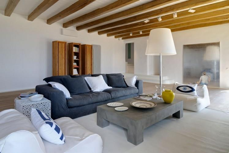 living area with unique designed pillows and huge white lamp