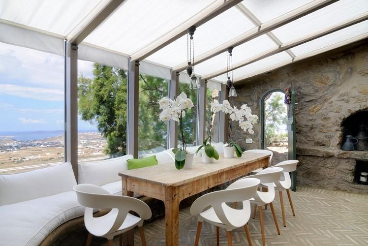 modern designed outdoor dining area with windows for brighter room