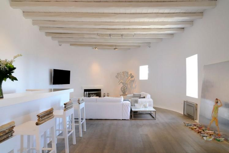 white wall living room with flat screen tv and beautiful sculpture