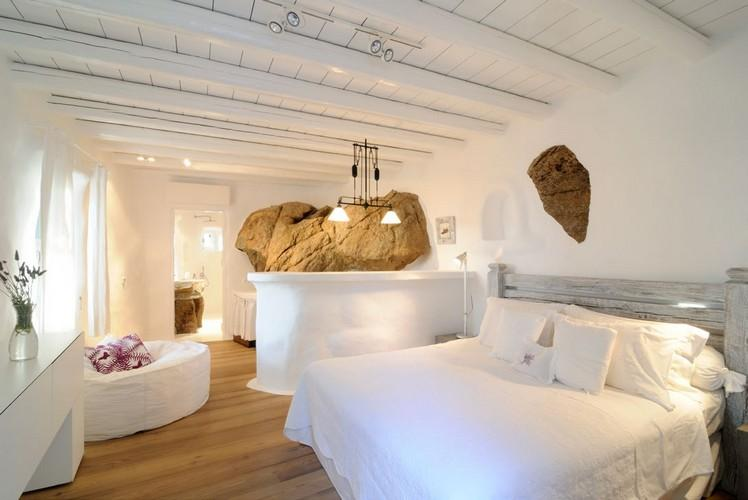 spacious white wall bedroom with bar and private bathroom