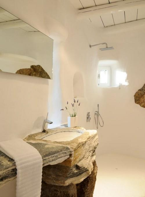 simply designed bathroom with rocky sink and shower