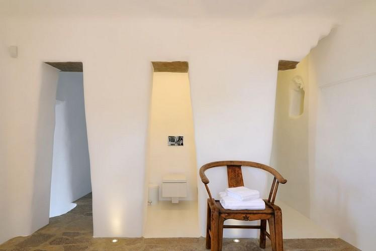 area in front of bathroom with wooden chair
