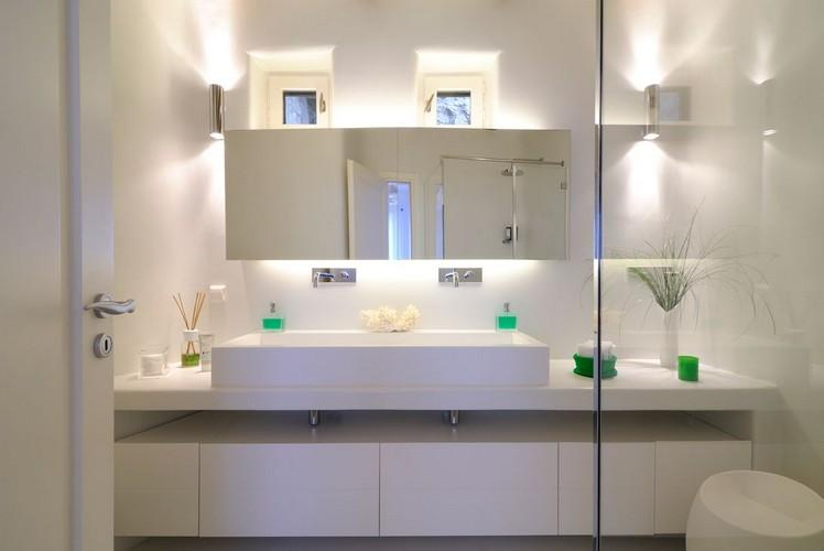 modern designed bathroom with illuminated mirror and huge sink