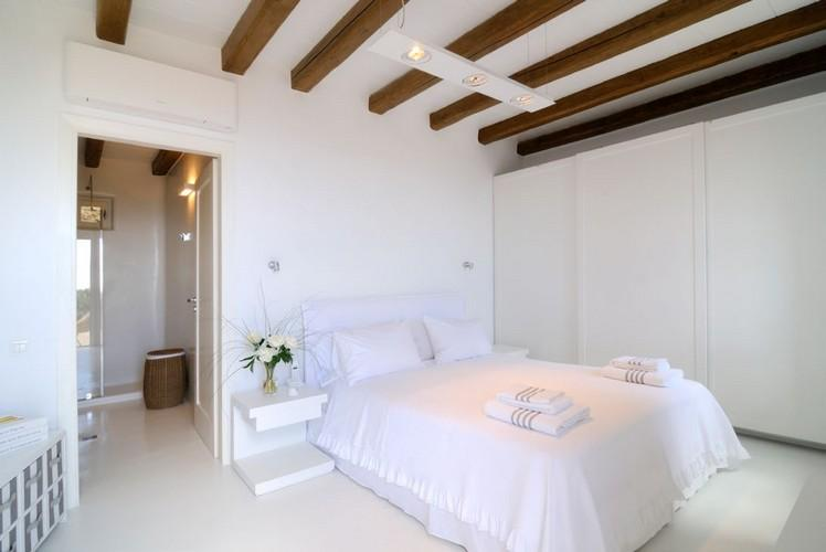 bedroom with white cabin and air condition