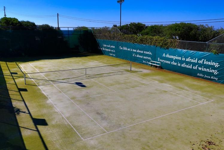 beautiful tennis court within the villa for recreation