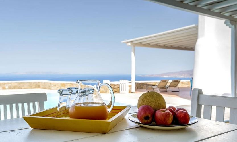 outdoor dining area with fresh fruit and homemade juice