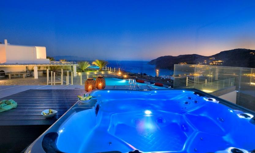 outdoor area with illuminated jaccuzi and breathtaking view