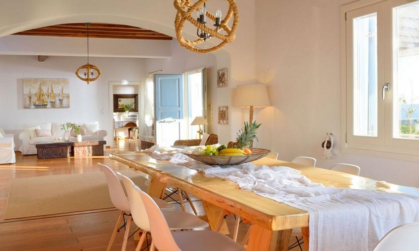 Villa_Patricia_27.jpg Super Paradise Mykonos Dining area, table, chairs, lamp, bed, pillows