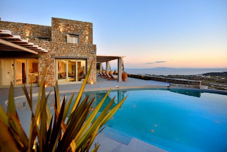 outdoor area with round pool and stunning sea and island view