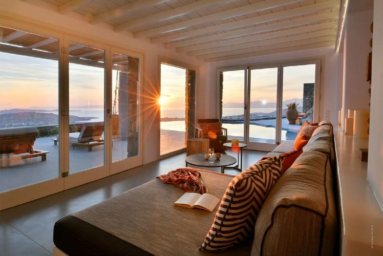 living room all in glass with beautiful sunset view