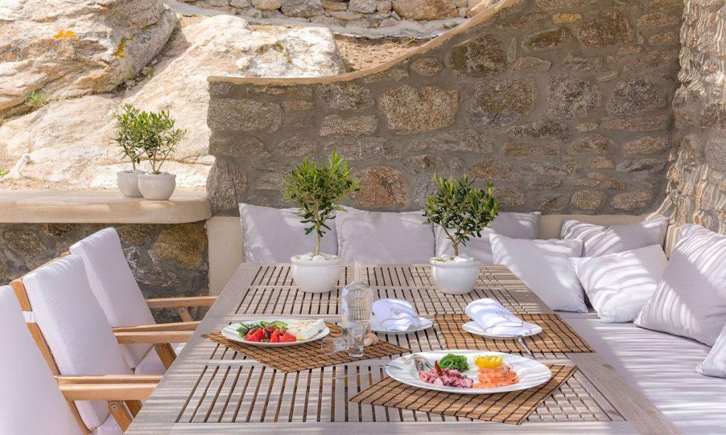 outdoor dining area with soft cushion perfect for eating a breakfast
