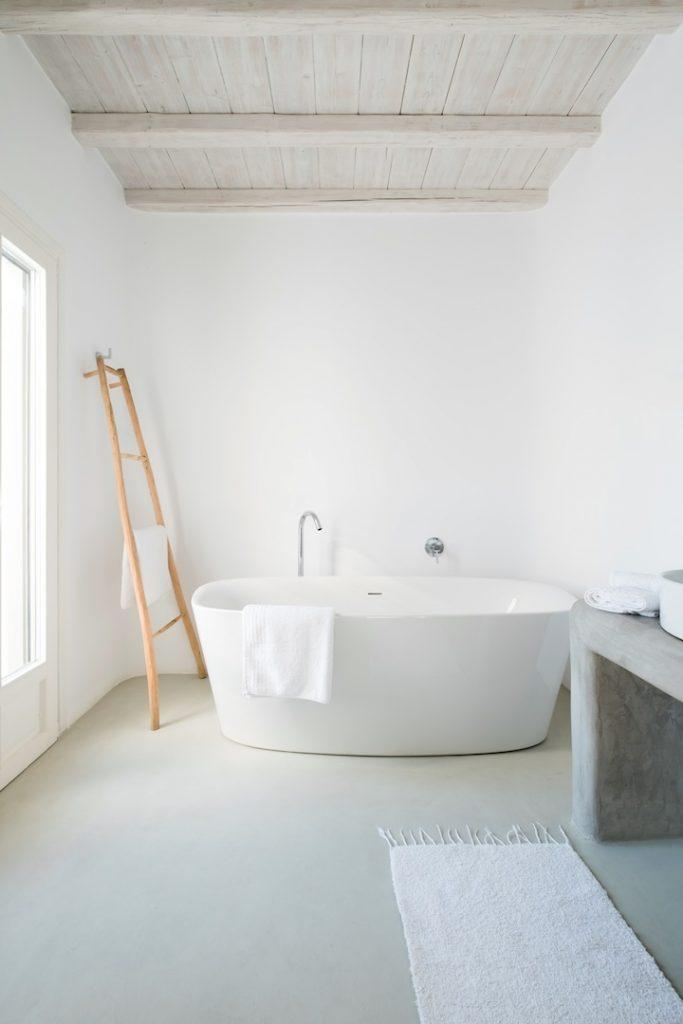 bathroom with bath to relax in and ladder