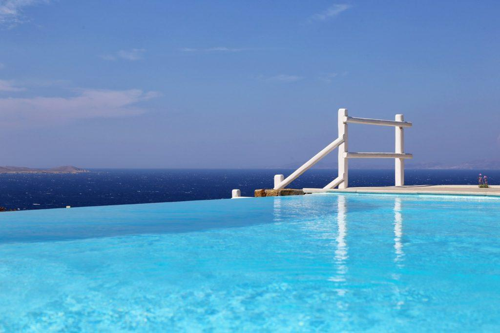 infinity pool with extraordinary view of houlakia beach and sea
