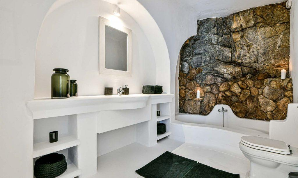 unique stone wall with candles and bath for atmosphere