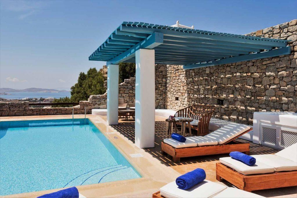outdoor resting area with swimming pool made for relaxation and enjoyment