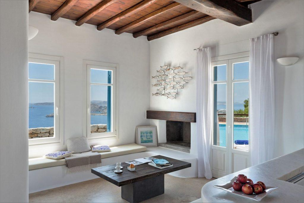 living room with an amazing view on mykonian sea and sky
