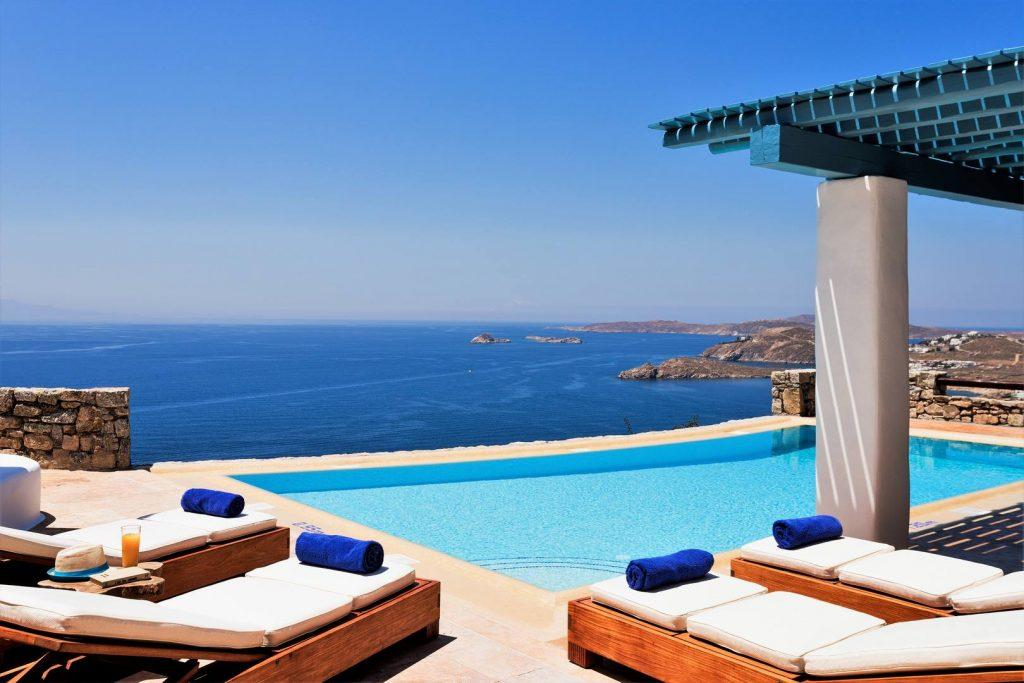 incredible sea view from the yard with a swimming pool and sunbeds in a perfect weather