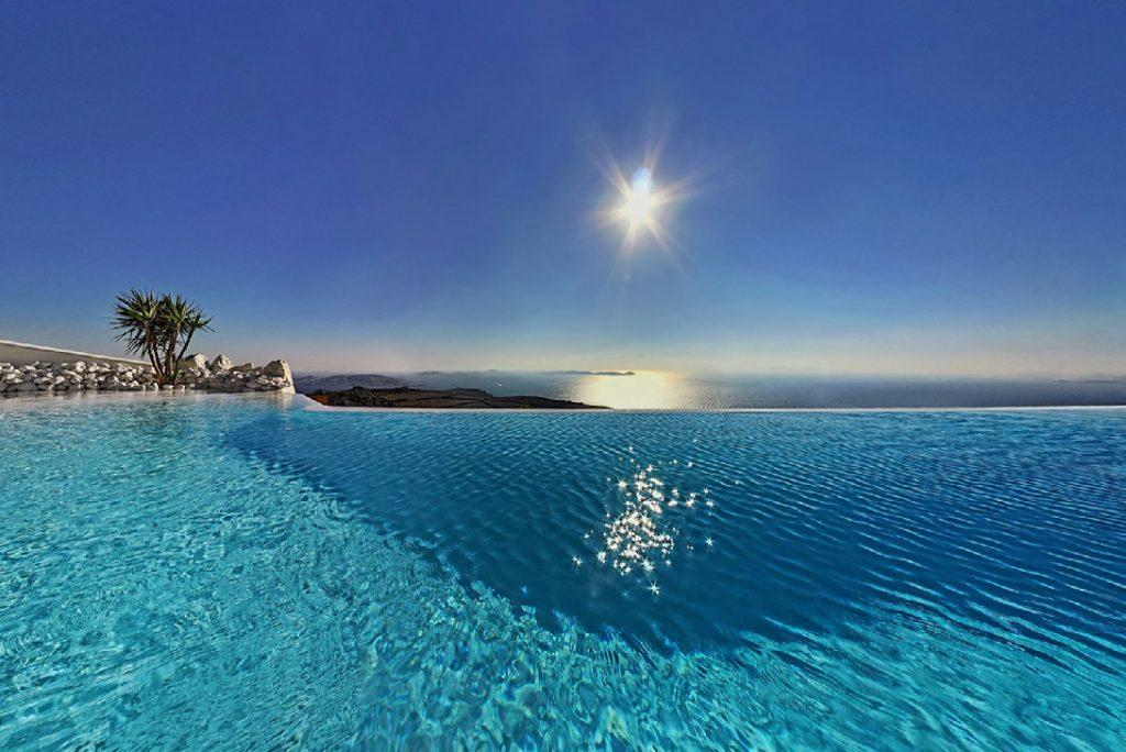 swimming pool with view of sea and sky