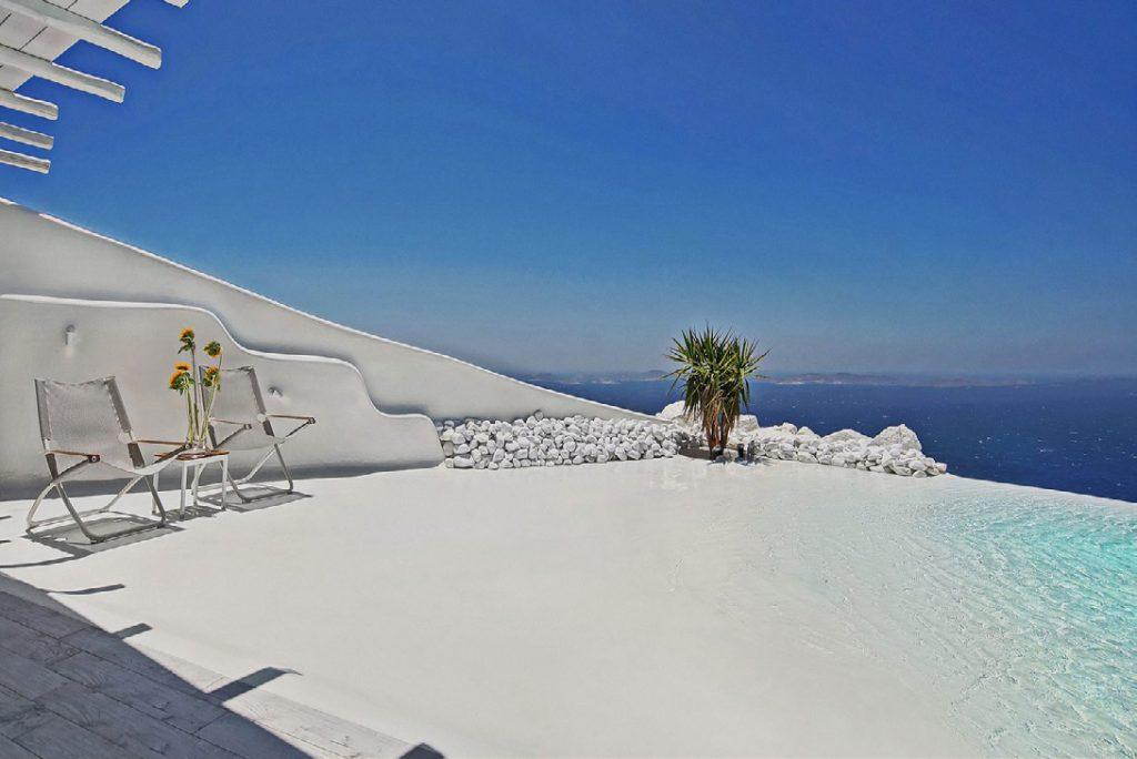 white wall balcony with swimming pool and white stones perfect for romantic honeymoon and private party