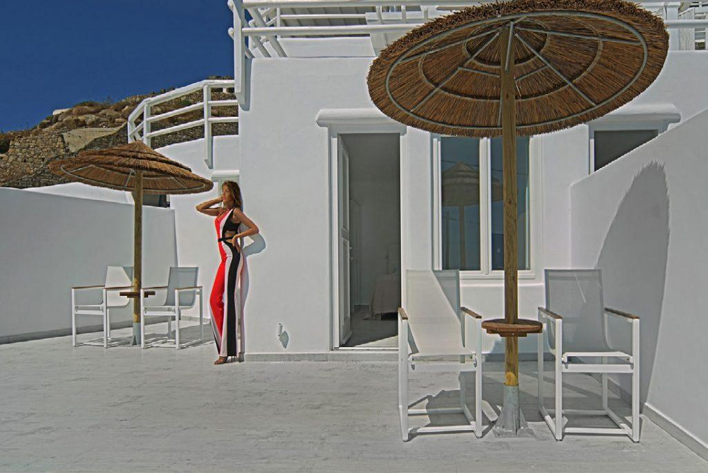 sunny exterior of whitewashed villa ideal for tanning and relaxing