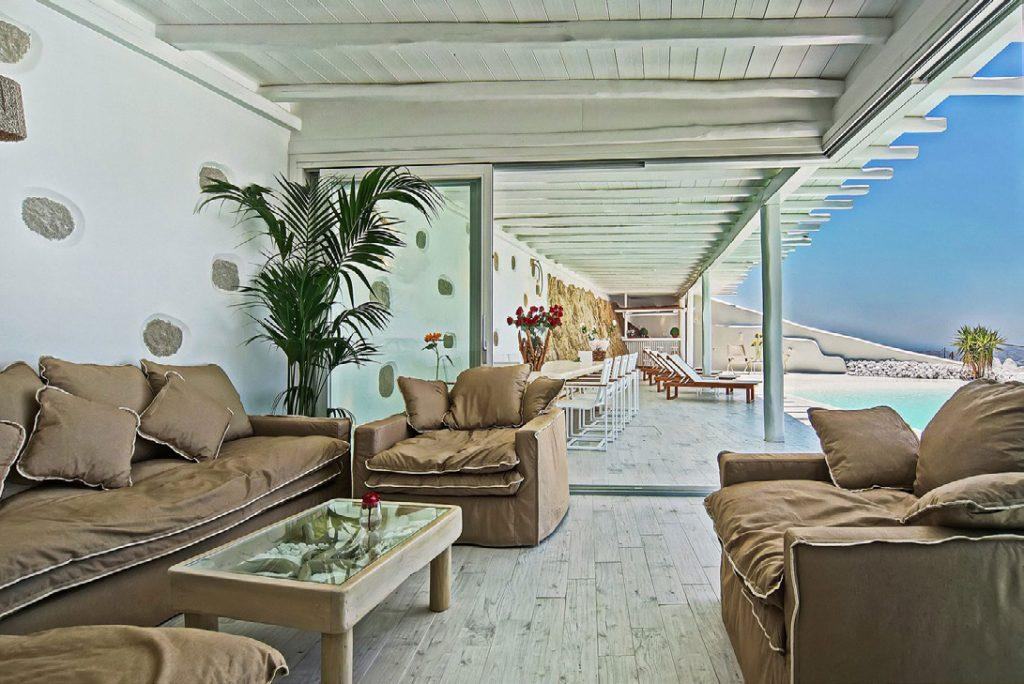 out door living room with chairs, sofa and view of swimming pool