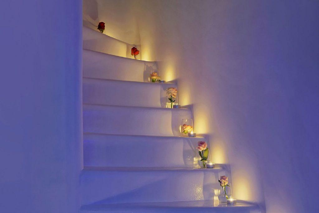 white stairs with candles and flowers