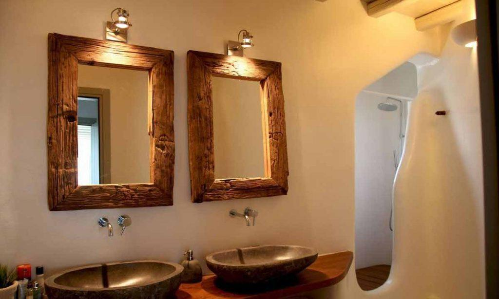 minimal design bathroom with two mirrors in wooden frame