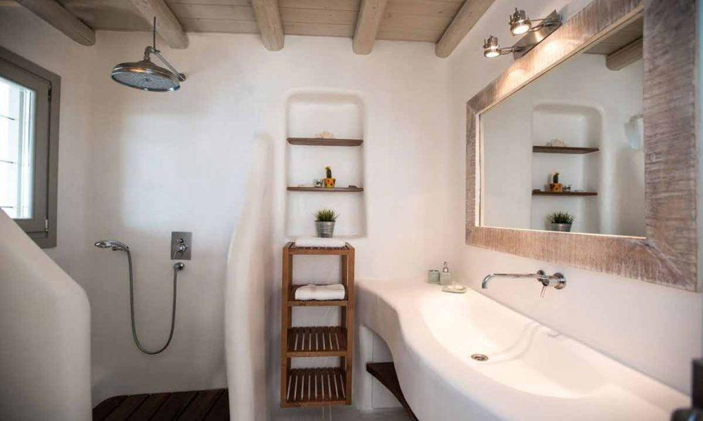 simply designed bathroom with large mirror and sink
