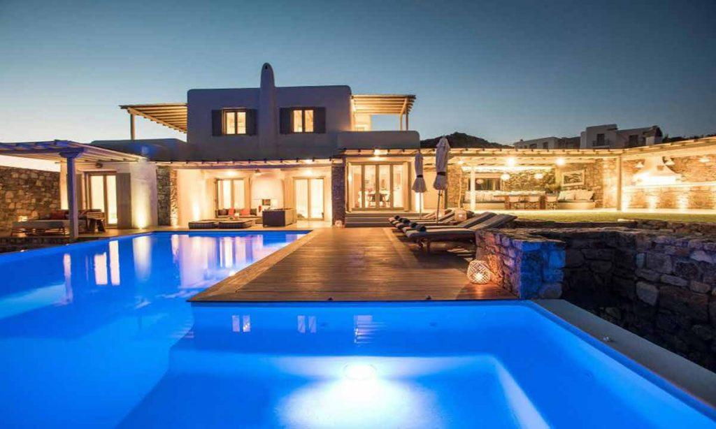 outdoor area with illuminated pool perfect for night parties