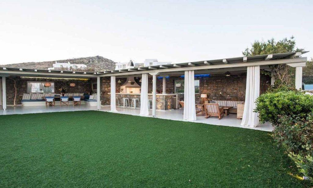outdoor dining area with beautiful and satisfying view of green grass