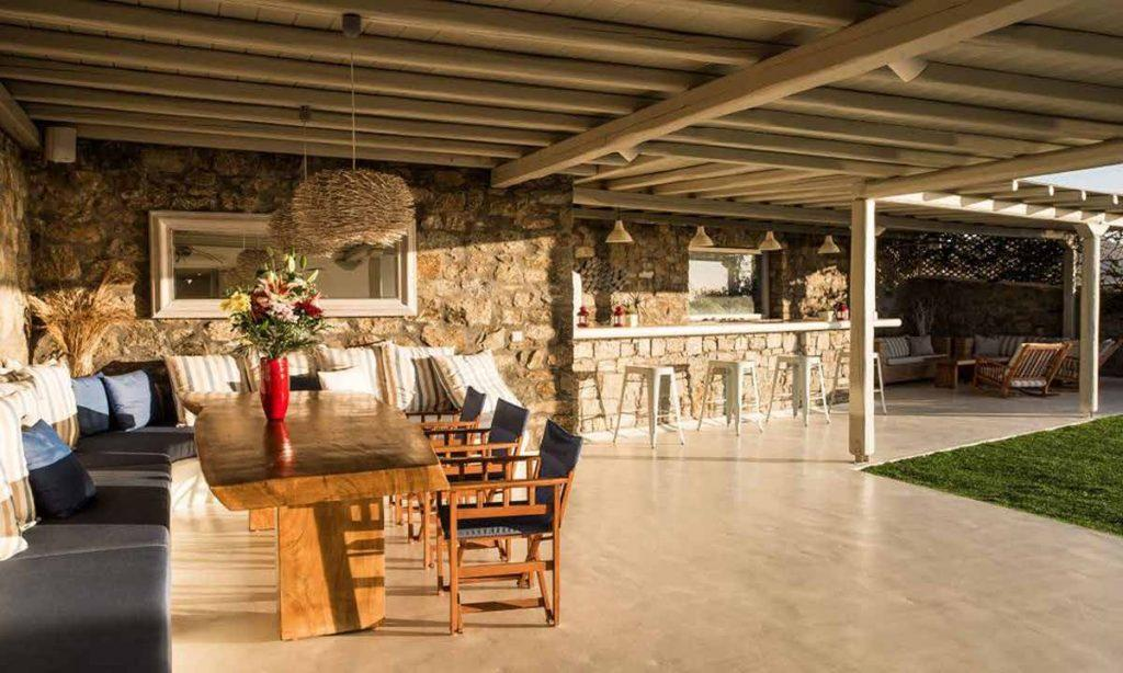 outdoor dining area with stone walls and bar perfect for parties