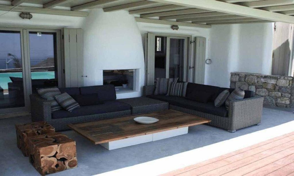 living outdoor area with two sofas and large table