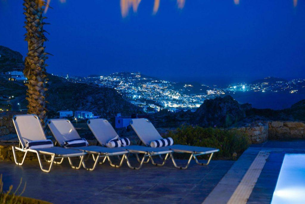 Villa Umabel, Agios Stefanos, Mykonos, Swimming pool, Pool, Stone wall, Balcony, Sky, Sunbeds, Towels