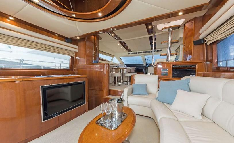 Yacht_Beluga_03.jpg Mykonos Living area, flat screen tv, bottle, bed, pillows, glass, table