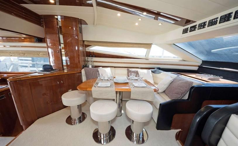 Yacht_Beluga_06.jpg Mykonos Dining area, chairs, bed, pillows, table, cabinet, window