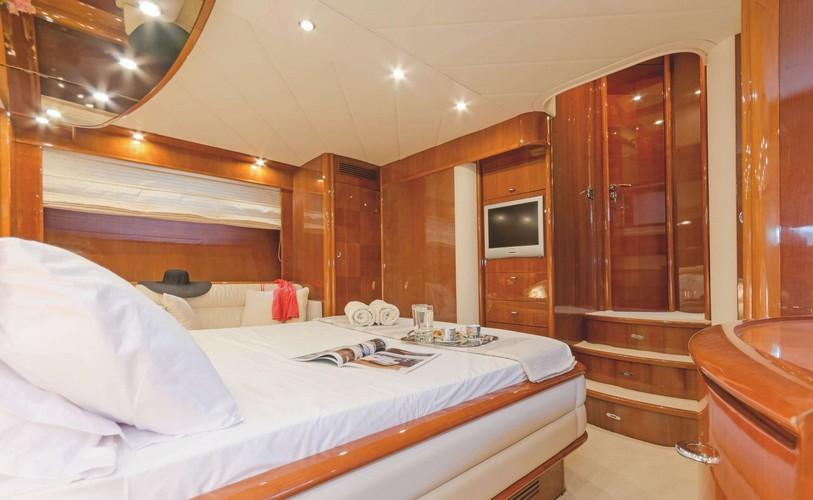 Yacht_Beluga_08.jpg Mykonos 1st Bedroom, bed, pillows, towels, cabinet