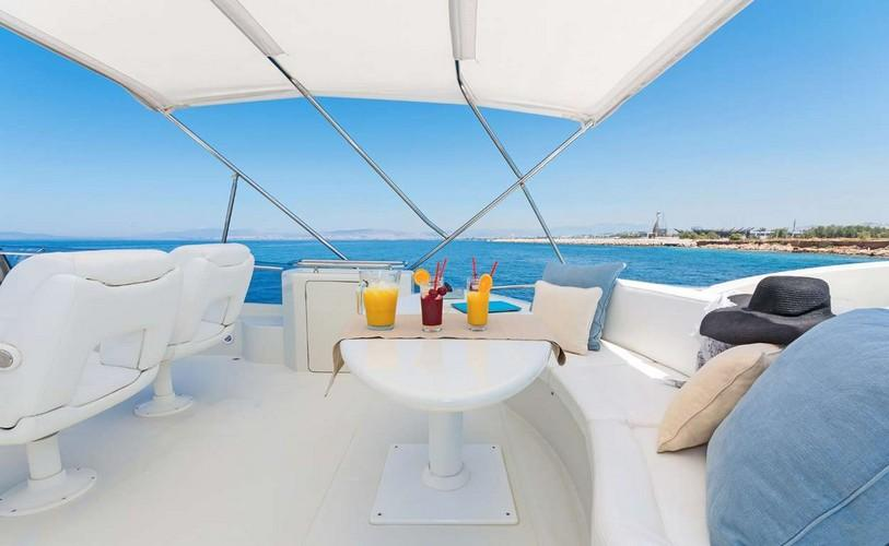 Yacht_Beluga_14.jpg Mykonos Outdoor Dining area, table, glass, juice, hat, pillows