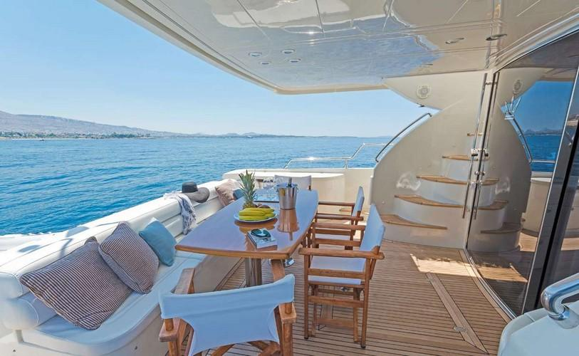 Yacht_Beluga_15.jpg Mykonos Outdoor Dining area, bed, pillows, chairs, stairs, sky