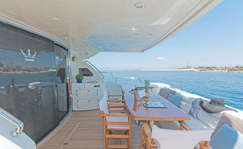 Yacht_Beluga_16.jpg Mykonos Outdoor Dining area, table, chairs, vase, hat